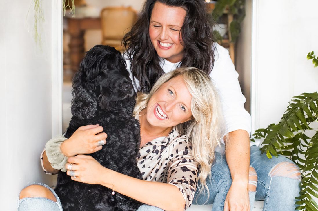 Two dog mums and a black cocker spaniel